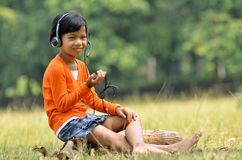 Girl with Headset 03 Stock Photos