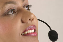 Girl with Headset. Beautiful girl operator and headset Royalty Free Stock Image