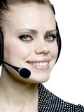 Girl  with a headset. Beautiful smiling attractive young girl  with a headset Stock Images