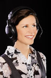 Girl in headset Royalty Free Stock Image
