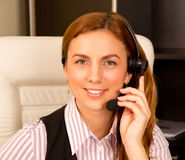 Girl with headset. In a office Royalty Free Stock Photography