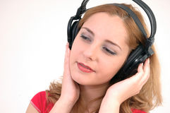 Girl with headset in a deep trance Stock Photos