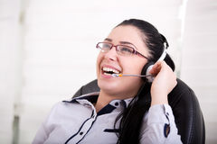 Girl with headset laughing Stock Photos