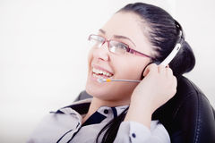 Girl with headset laughing Royalty Free Stock Image