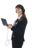 Girl with headset and netbook Stock Photos