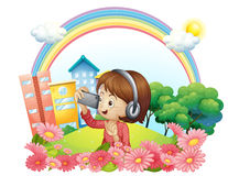 A girl with a headset and a phone with camera Royalty Free Stock Photo