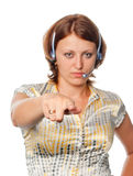 Girl with headset points a finger Royalty Free Stock Photography