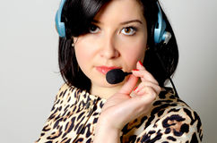 Girl in headset. Girl in headset for remote consultation and receiving applications royalty free stock photography