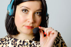 Girl in headset. Girl in headset for remote consultation and receiving applications stock image