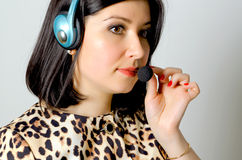 Girl in headset. Girl in headset for remote consultation and receiving applications royalty free stock photos