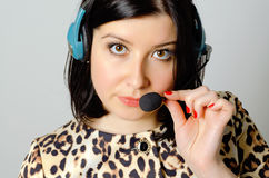 Girl in headset. Girl in headset for remote consultation and receiving applications stock photography