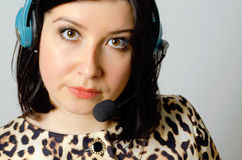 Girl in headset. Girl in headset for remote consultation and receiving applications royalty free stock image