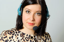 Girl in headset. Girl in headset for remote consultation and receiving applications royalty free stock images