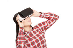 Girl in headset of VR watching video. Stock Photo