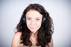 Girl in headsets Royalty Free Stock Photo