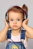 Girl with headsets. Royalty Free Stock Images