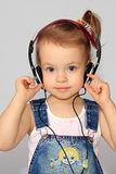 Girl with headsets. Stock Image