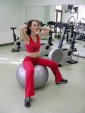 Girl in health club on ball Stock Images