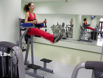 Girl in healthclub. Motion legs stock photography