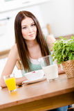Girl with healthy cereals and orange juice Royalty Free Stock Photos