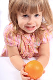 Girl with healthy fruit Royalty Free Stock Photography