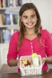 Girl With Healthy Lunchbox In Kitchen Stock Photography