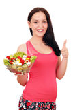 Girl with healthy salad and thumb up Royalty Free Stock Photography