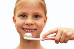 Girl with healthy teeth holding a toothbrush Stock Image