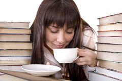 Girl with heap book and  cup. Royalty Free Stock Photo