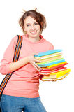 The girl with a heap of books Royalty Free Stock Photography