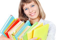 The girl with a heap of books. On a white background Stock Images