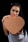 The girl with a  heart Stock Images