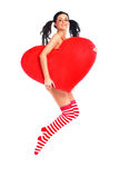 Girl with a heart. Sexy young jumping woman with a big heart in her hands Stock Photos