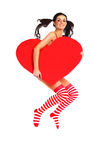 Girl with a heart. Sexy young jumping woman with a big heart in her hands Royalty Free Stock Image