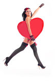 Girl with a heart. Sexy young jumping woman with a big heart in her hands Royalty Free Stock Photos