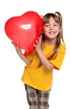 Girl with heart. Portrait of little girl with red heart balloon over white background Royalty Free Stock Photos