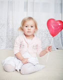 Girl with heart balloon Stock Photo