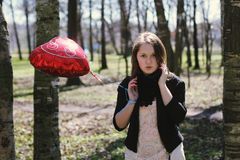 Girl with heart balloon Royalty Free Stock Photos