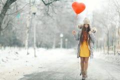 Girl with heart balloon Royalty Free Stock Photos