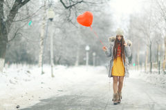 Girl with heart balloon Stock Photography