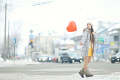 Girl with heart balloon Royalty Free Stock Images