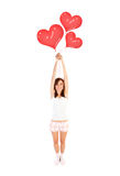 Girl with heart balloons Stock Photo