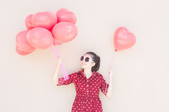 Girl With Heart Balloons Series Stock Photo