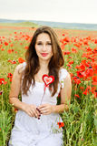 Girl with heart in field Stock Images