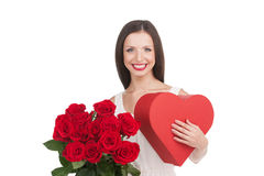 Girl with heart and flowers. Royalty Free Stock Photos