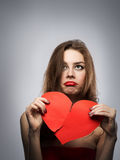 Girl with heart. On gray background Royalty Free Stock Photography