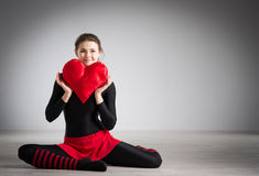 Girl with a heart in his hands Stock Photos