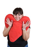 Girl with heart pillow Stock Photography