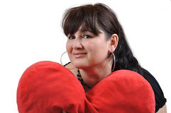 Girl with Heart pillow Royalty Free Stock Photo