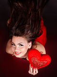 Girl with heart  in red flying. Stock Photography